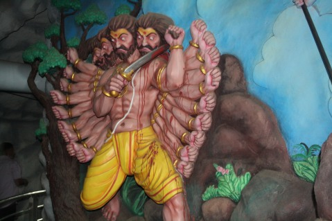 Ravana cutting his heads as sacrifice