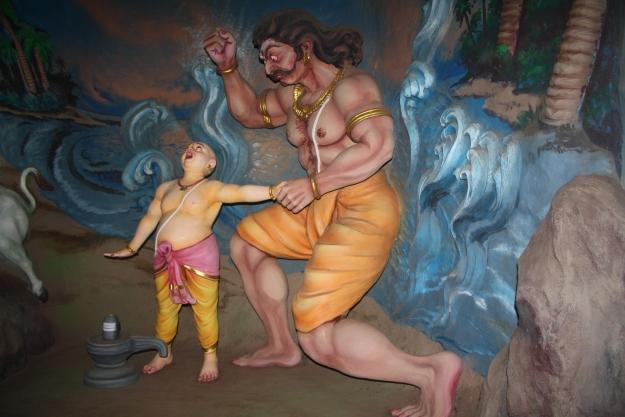 Enraged he hit the Bramhin boy (Ganesha)